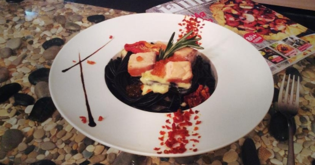 Black Pasta in a Creamy Sauce with Salmon and Red Caviar