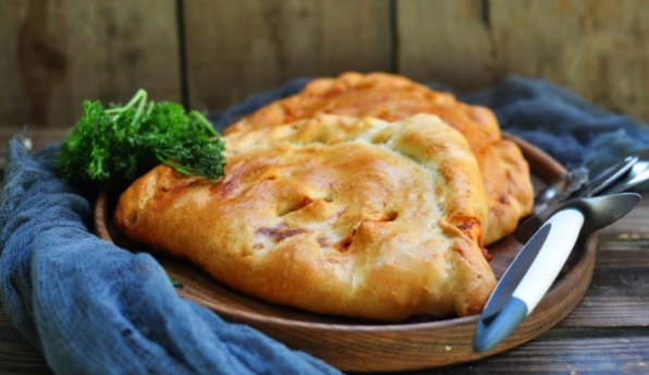 Pizza Calzone with Vegetables and Cheese