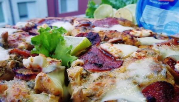 Delicious Pizza with Curd Cream, Figs and Sujuk