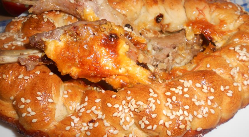 Baked Rabbit in a Rim of Dough with Sesame Seeds