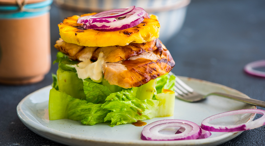 Burger with Turkey and Pineapple on a Head of Lettuce