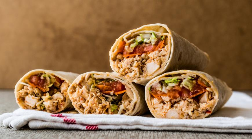 Homemade Shawarma with Tomatoes, Chicken, Cabbage and Cucumber Salad and Spicy Sauce