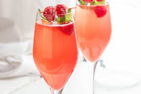 Orange-raspberry cocktail with champagne
