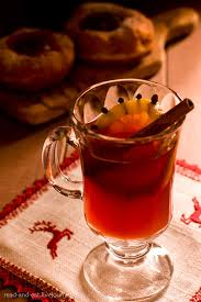 Hot port wine with black leaves and orange