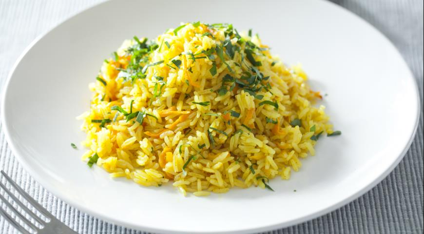 Delicious, aromatic rice with carrots for garnish