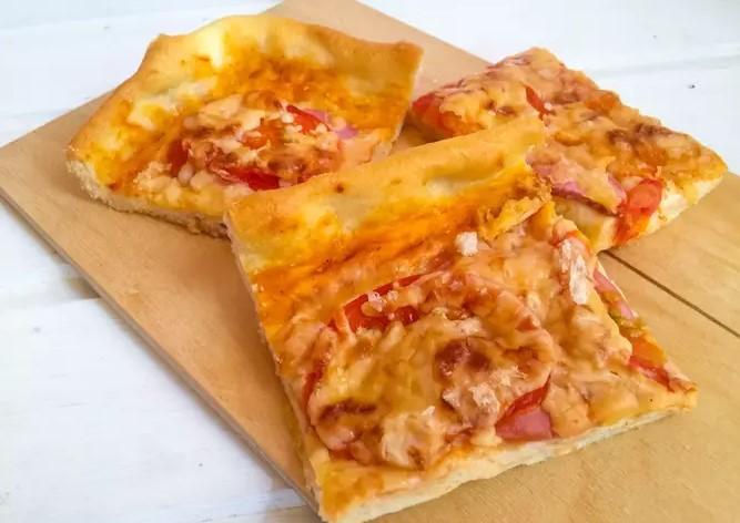 Homemade pizza with boiled sausage