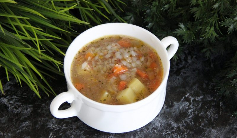 Potato soup with stewed meat and buckwheat