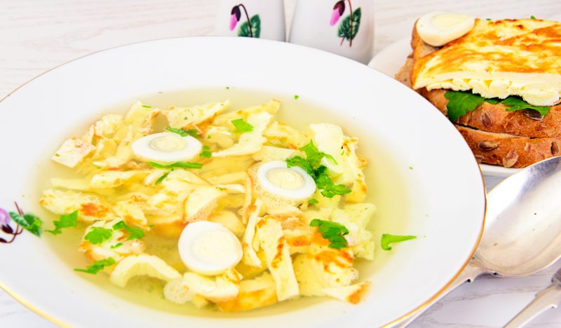 Chicken soup with omelet and vegetables