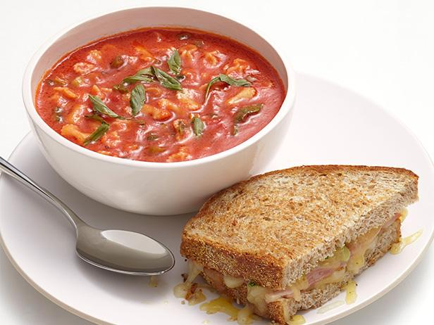 Tomato soup with fresh tomatoes with cheese sandwiches