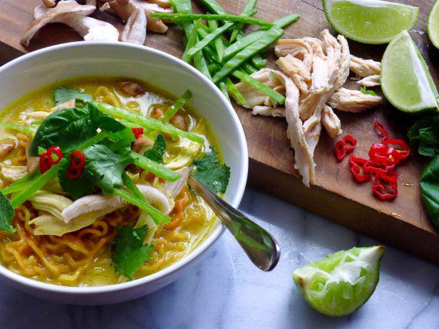 Spicy soup with coconut milk with curry and noodles