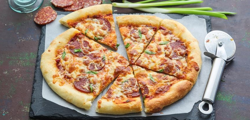 Pizza with smoked sausage and cheese