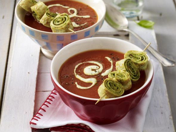 Tomato puree soup with pancakes with herbs