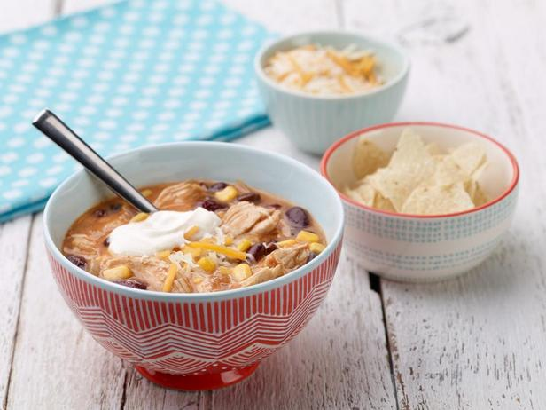 Tortilla soup with chicken and cheddar cheese