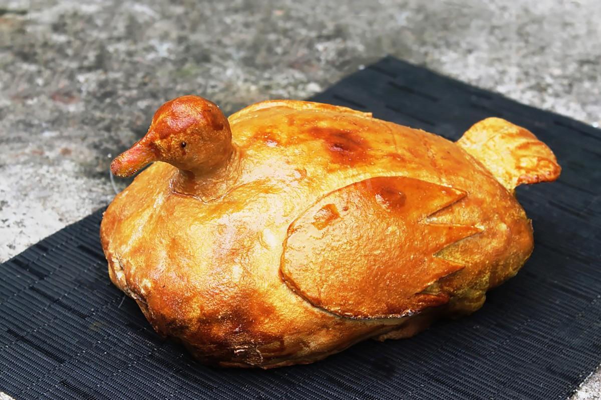 Wild duck baked in dough