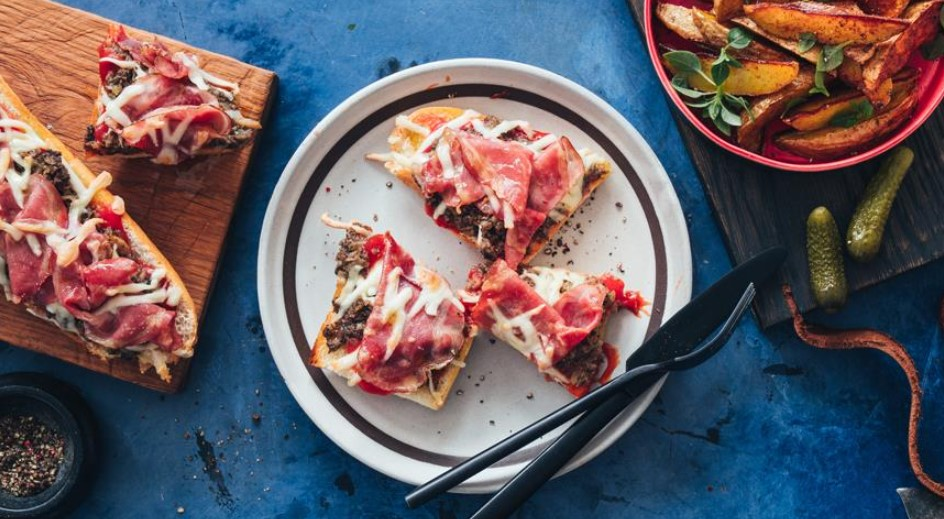 Pizza with ham and mushrooms on a French baguette