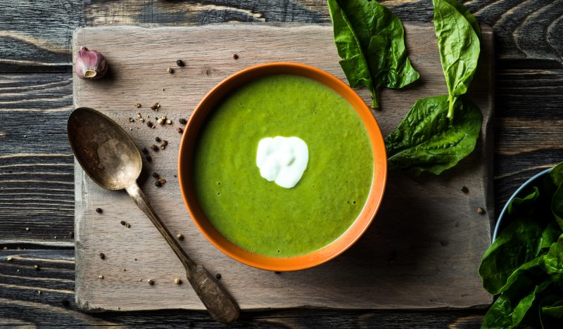 Soup with spinach, green onions and peas