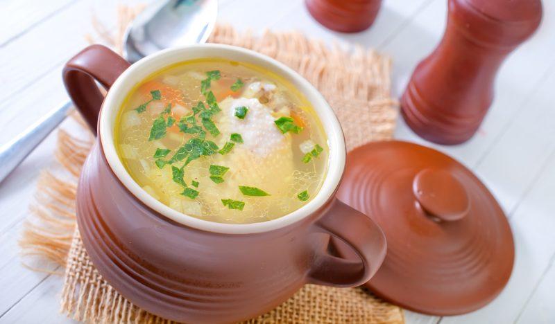Chicken soup in pots