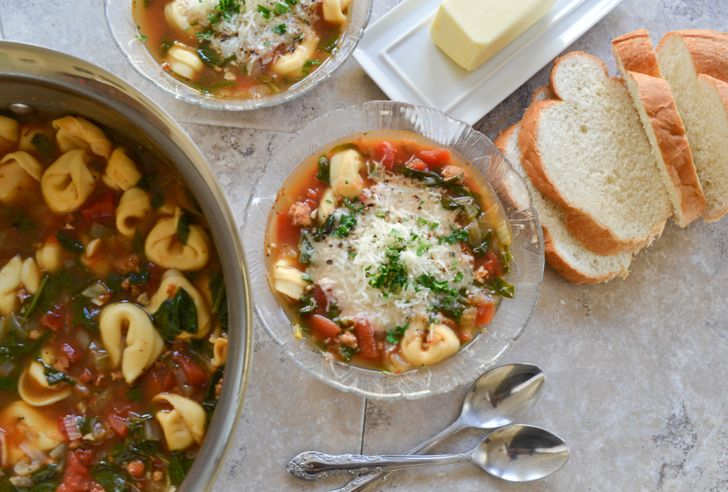 Delicious Italian tomato soup with tortellini and spinach