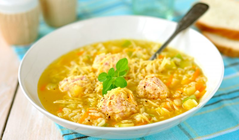 Soup with meatballs, zucchini and rice
