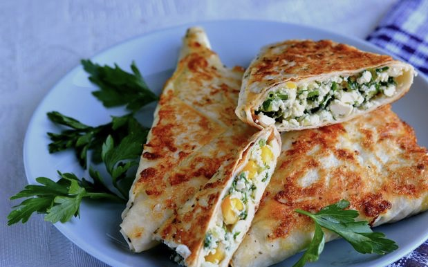 Lavash envelopes with cottage cheese, corn, cucumber and herbs