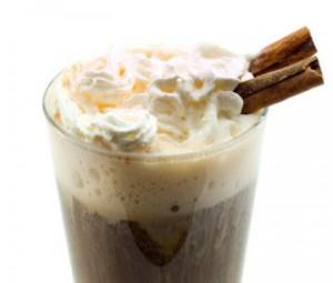 Coffee grog with cream, spices and orange zest