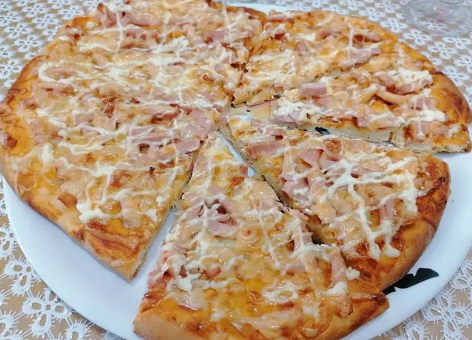Pizza on thin yeast dough