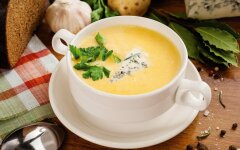 English chicken soup with melted cheese and rice