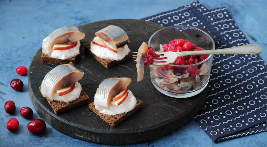 Norwegian herring appetizer with cranberry sauce and herring canapes