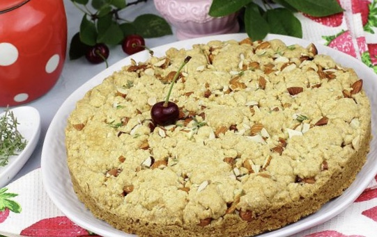 Chopped dough pie with cherries and almonds