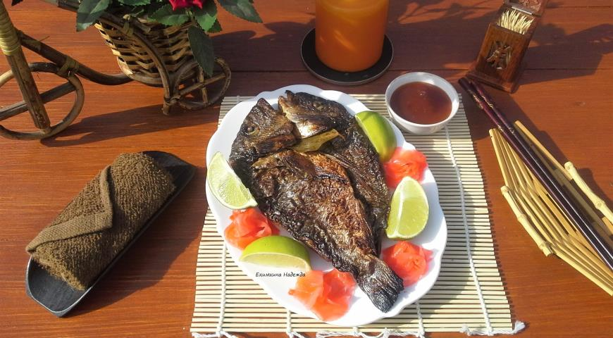 Fish - Thai style in a cast-iron bowl on charcoal