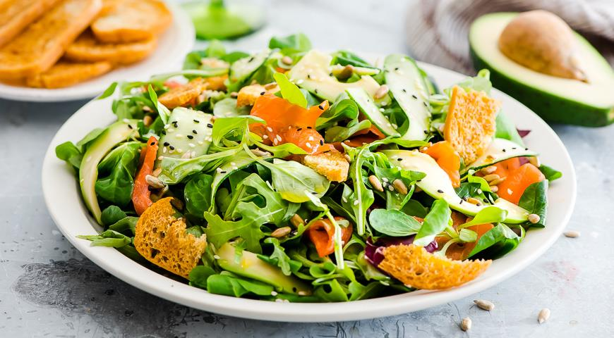 Festive summer salad with salmon and avocado