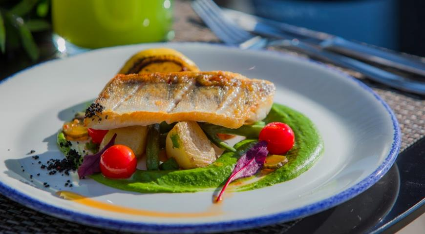 Pike perch fillet with green pea mousse and seasonal vegetables