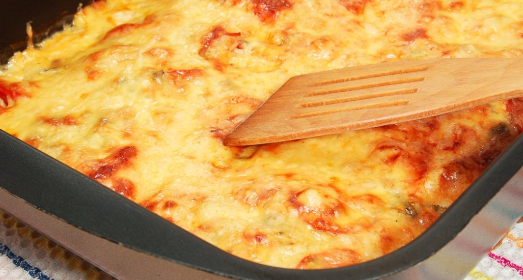 Pork baked with potatoes, tomatoes and cheese