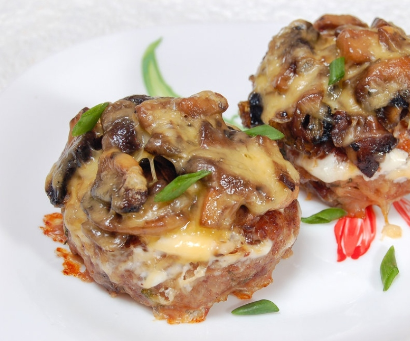 Cutlets baked with mushrooms and cheese