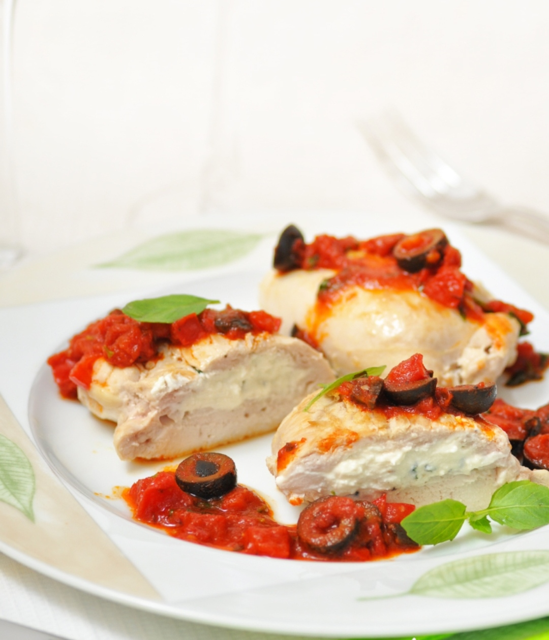Chicken breast pockets with feta cheese and tomato sauce