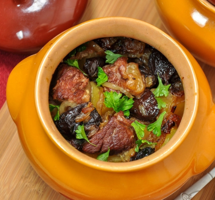 Lamb with potatoes and prunes, stewed in a pot