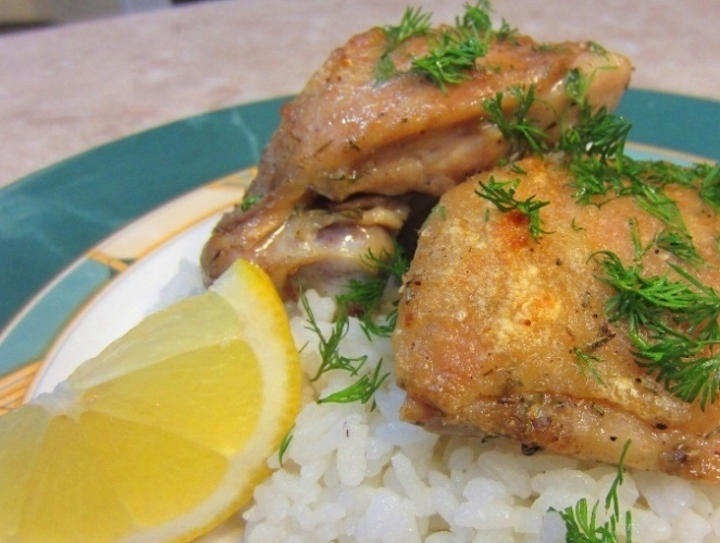 Baked chicken thighs with thyme and olive oil