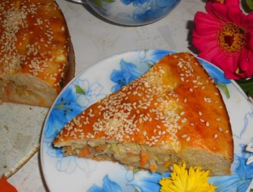 Pie with Cabbage and Meat with Sesame Sprinkles