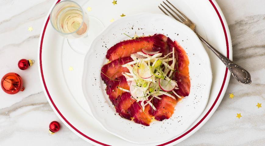 Radish and salmon salad marinated in beetroot juice