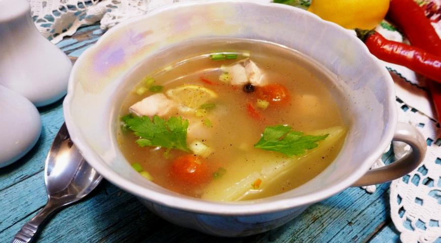 Fish soup with millet and tomatoes