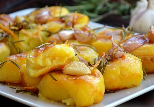 Potatoes baked with rosemary, garlic, zest and butter