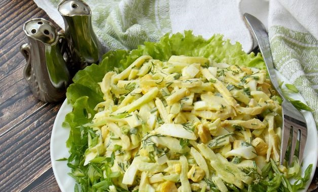 Squid salad with corn, cucumbers and eggs