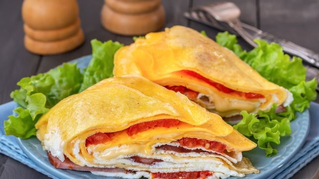 Layered omelet with ham, tomatoes and cheese