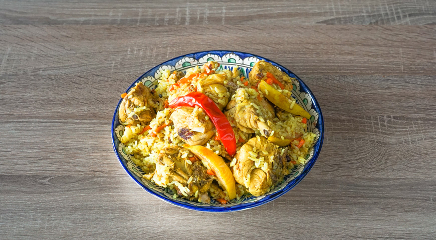 Pilaf with chicken in a cauldron