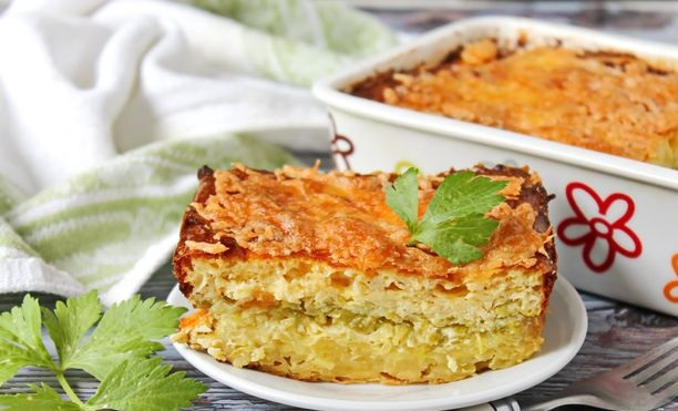 Potato casserole with zucchini, cottage cheese and cheese