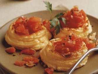 Potato soufflé with tomatoes in the form of bird's nests