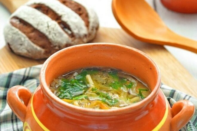 Cabbage soup with bell pepper in a pot