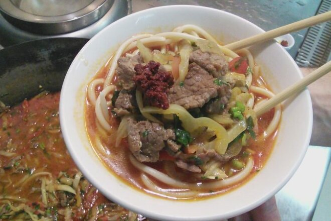Beef lagman with cabbage