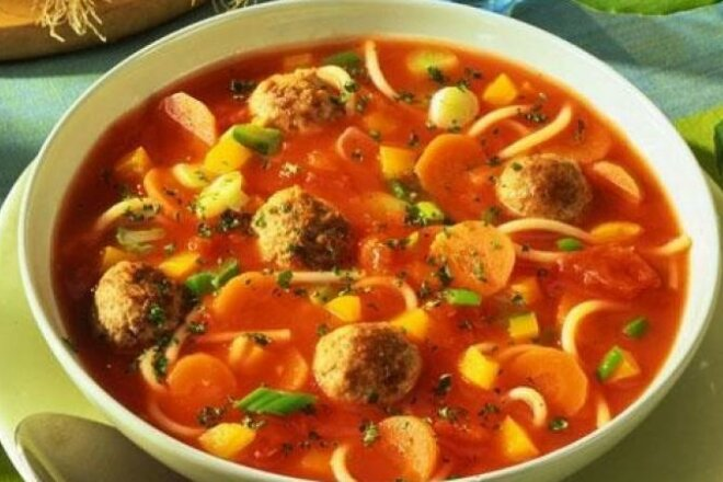 Italian tomato soup with sausages and noodles