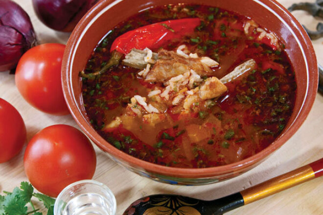 Kharcho soup with tomatoes and pomegranate juice in a slow cooker